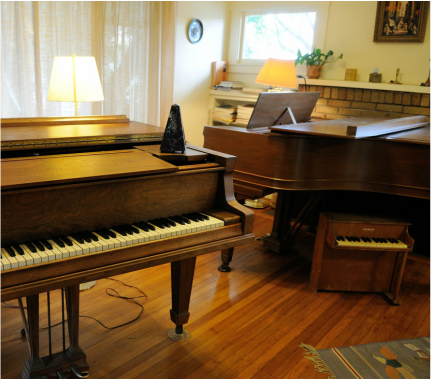 Grand Pianos, metronome and toy piano in Bruce's studio
